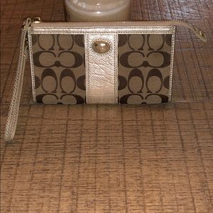 Beige and gold Coach wristlet